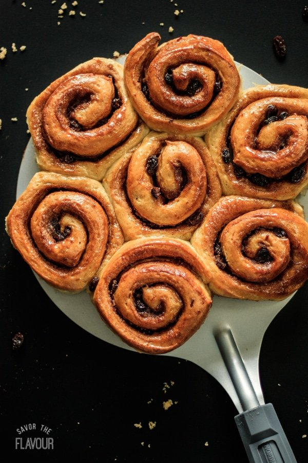 cinnamon buns on a cake lifter
