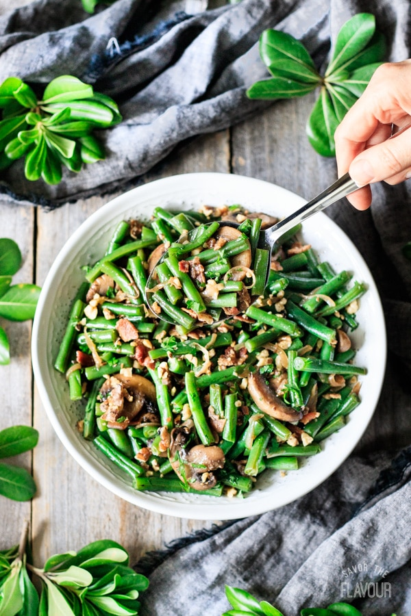 spoonful of green beans with bacon and mushrooms