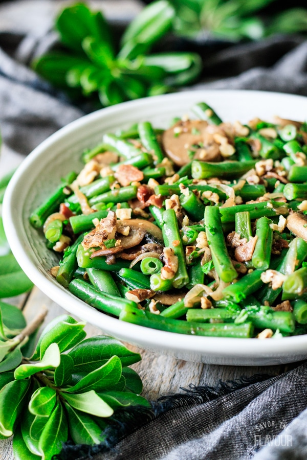 bowl of green beans with bacon and mushrooms