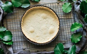 baked tart shell of flaky shortcrust pastry