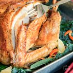 sliced roasted turkey with fork
