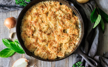 scalloped potatoes in a cast iron skillet