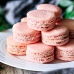 stacks of strawberry macarons on a plate