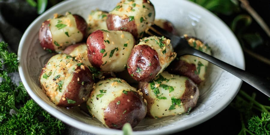 bowl of buttery garlic parsley potatoes