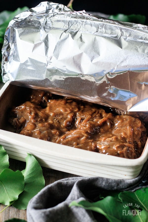 covering the Salisbury steak patties with foil