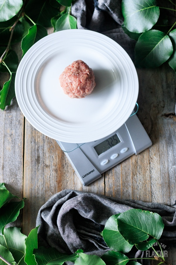 weighing the balls of raw beef on a scale