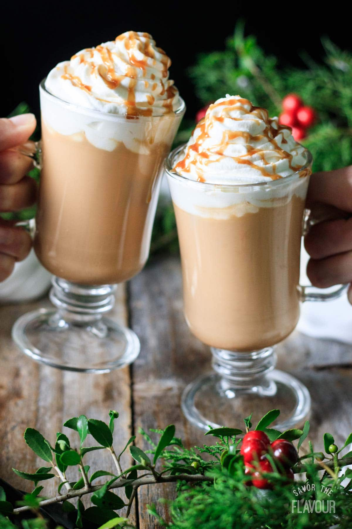 people doing a toast with two salted caramel mochas
