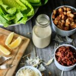 bottle of Caesar salad dressing with bacon and croutons
