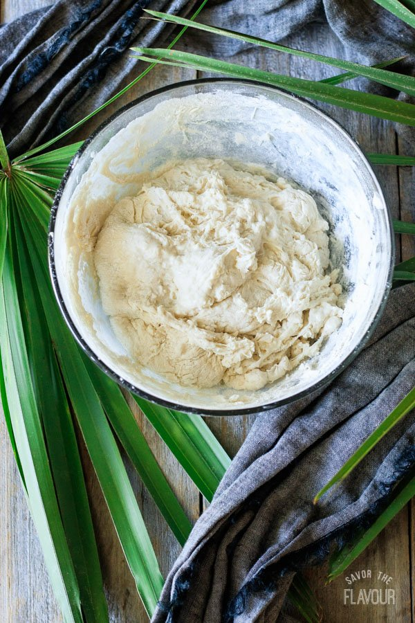 adding flour to dough