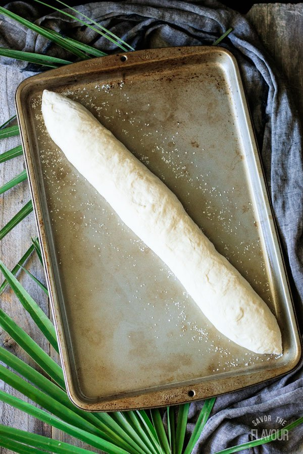 loaf of Cuban bread on a cookie sheet