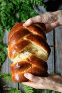 A loaf of challah bread being torn apart