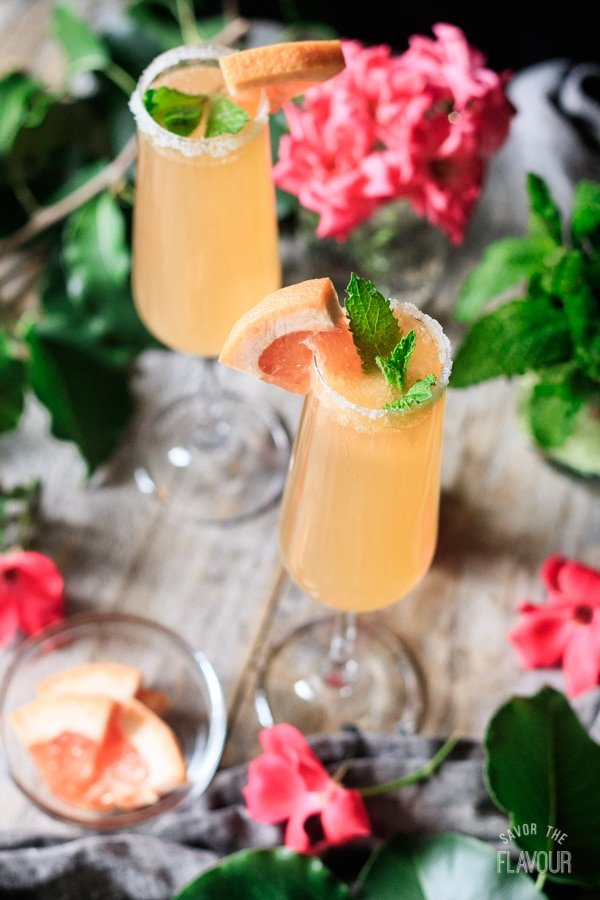 side view of two glasses of grapefruit ginger fizz