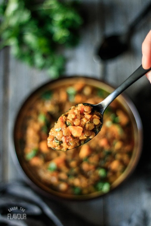 Detox Moroccan Lentil Stew is a gluten-free recipe that will help cleanse your body. This low carb stew is full of sweet potatoes, lentils, turmeric, and spinach. Make this healthy stew and get your clean eating and weight loss goals back on track. | www.savortheflavour.com #detox #cleaneating #glutenfree #lowcarb #healthyeating