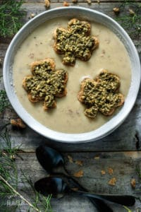 Smoky Cheese, Potato, and Ham Soup: an easy recipe that is made in your Dutch oven. It has smoked Gouda, cubed ham, mashed potatoes, milk and roasted garlic which all comes together to make the best one pot meal. Make it fun for your kids by floating shamrock toast points in their bowls. | ww.savortheflavour.com #stpatricksday #irish #dinnerrecipe #cheese #ham