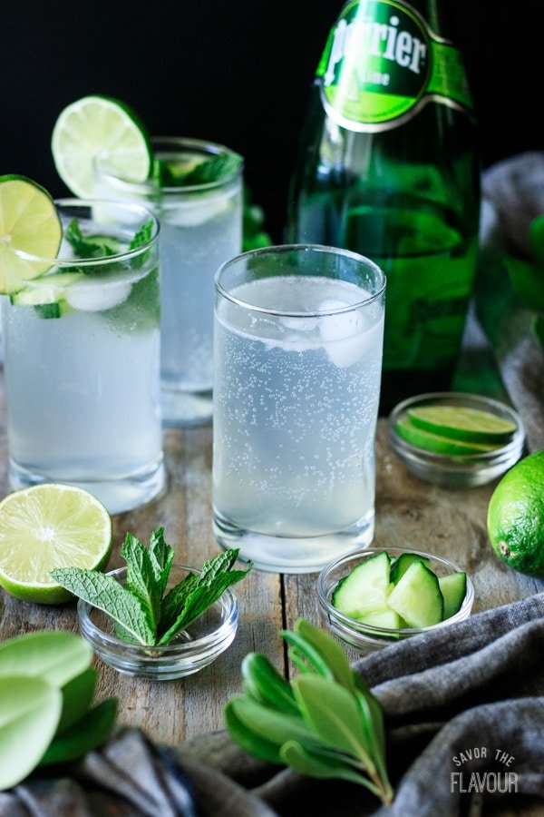 three glasses with bowls of mint and cucumber