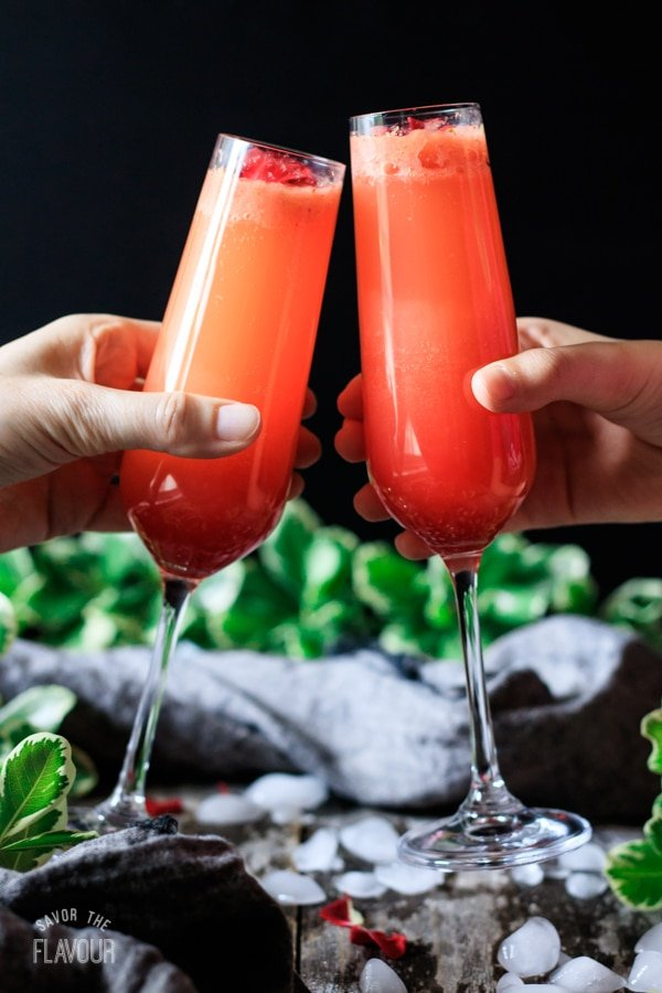people doing a toast with strawberry citrus blush drinks