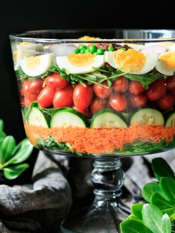 layered salad in a glass bowl