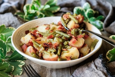 white bowl of Southern green beans and potatoes