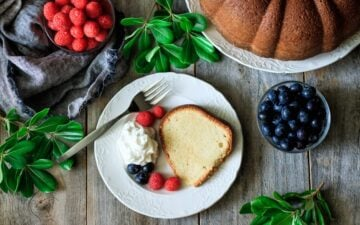 white plate of sour cream pound cake with fork