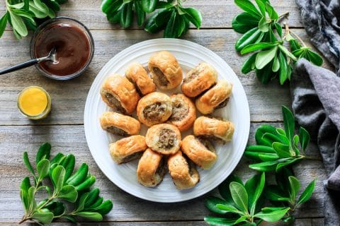 plate of sausage rolls with HP sauce and English mustard