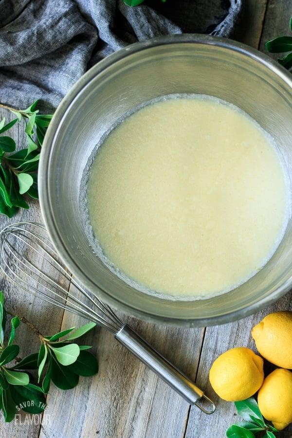 bowl of batter for lemon pudding cakes