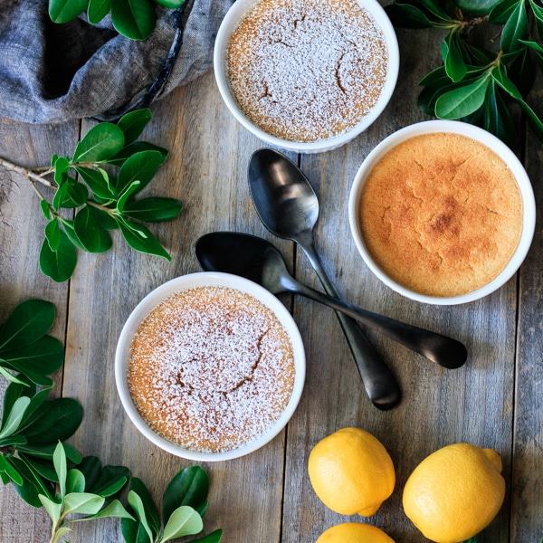 three lemon pudding cakes with fresh lemons