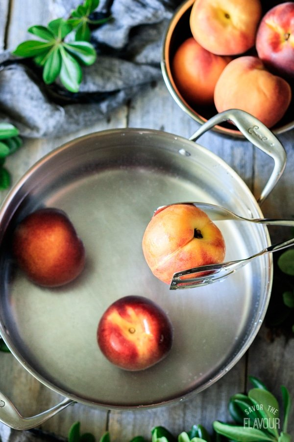 putting peaches in a pot of water