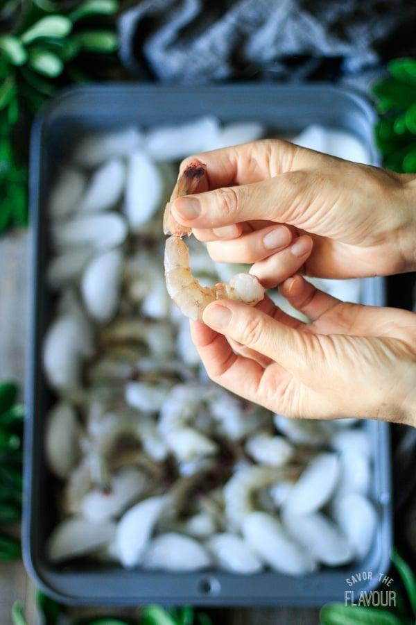 peeling shrimp for shrimp and grits