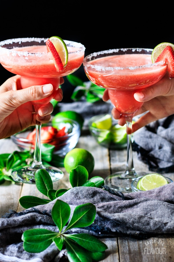 doing a toast with non alcoholic strawberry margaritas
