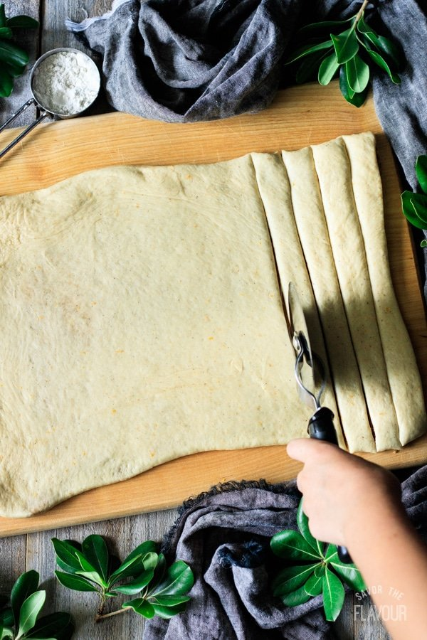 cutting strips of dough for Swedish cardamom buns