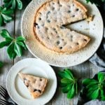 slice of blueberry frangipane tart on a plate