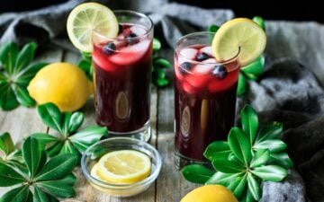 two glasses of blueberry lemonade