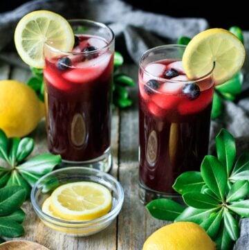 two glasses of blueberry lemonade
