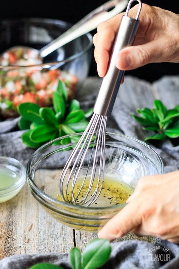 whisking the dressing for cactus salad