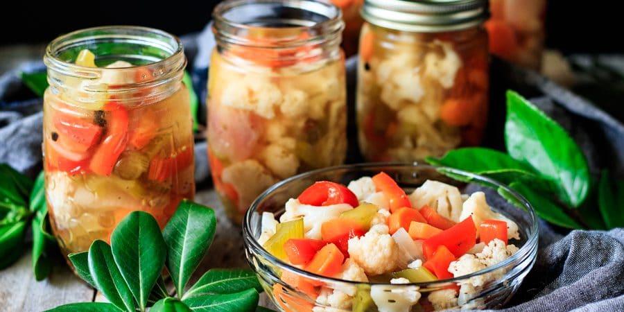 a bowl and jars of giardiniera