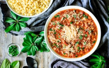 bowl of minestrone soup with a bowl of pasta