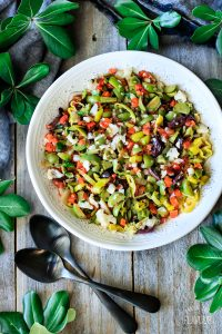 bowl of olive salad for muffaletta with spoons
