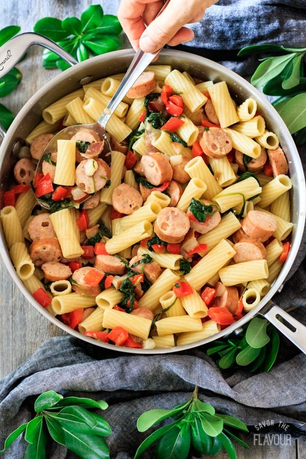 sausage, pear, and gouda rigatoni in a skillet