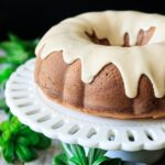 maple walnut bundt cake on a cake stand