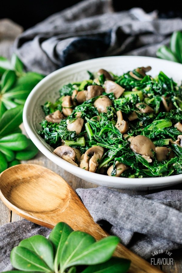 bowl of sautéed kale with mushrooms