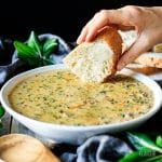 dipping bread into wild rice soup