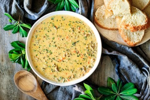 bowl of wild rice soup with bread