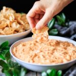 dipping a chip into buffalo chicken dip