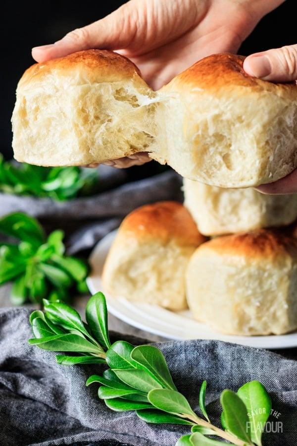 pulling apart two Hokkaido milk bread rolls