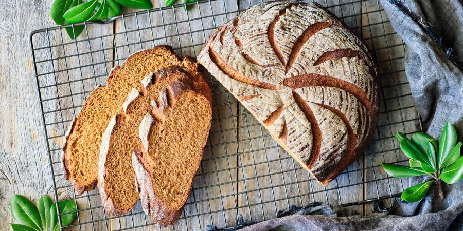 slices of whole wheat molasses bread with the loaf