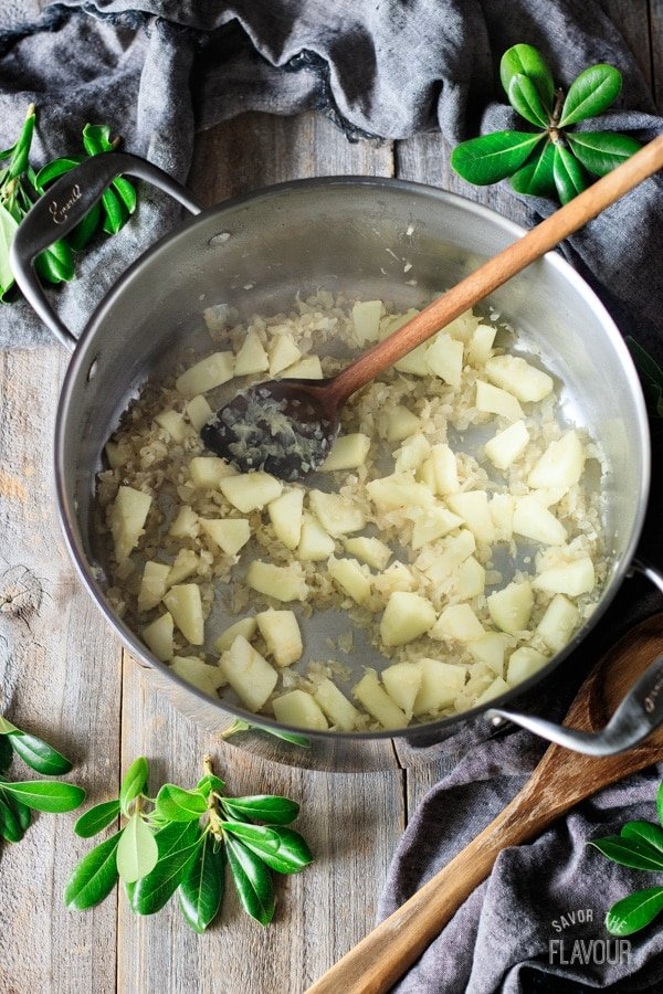 cooking the apple and onion for roasted cauliflower soup
