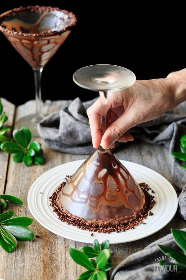 dipping rim of glass into sprinkles for non alcoholic chocolate mocha martini