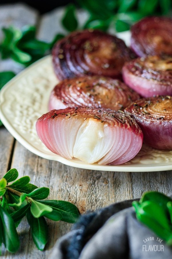 one of the marinated red onions cut in half