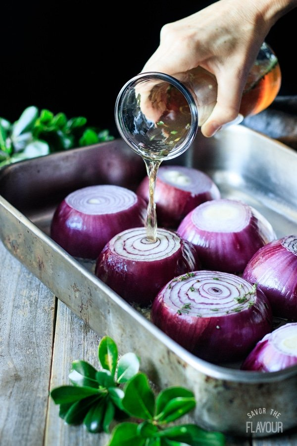 pouring the marinade on marinated red onions