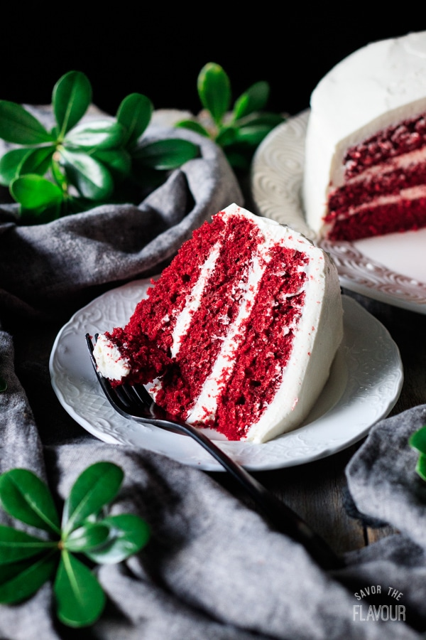 slice of red velvet cake on a plate with a fork